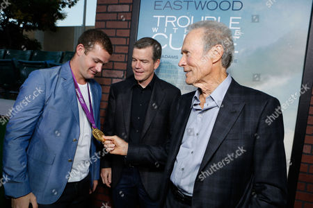 WESTWOOD, CA - SEPTEMBER 19: Olympic swimmer Tyler Clary, Director Robert Lorenz and Writer/Actor Clint Eastwood at The World Premiere Of Warner Bros. Pictures' 'Trouble With The Curve' held at Mann Village Theatre on September 19, 2012 in Westwood, California. Clint Eastwood Robert Lorenz Tyler Clary