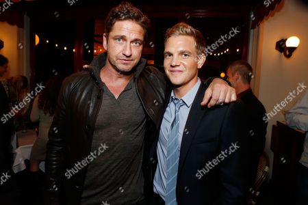 LOS ANGELES, CA - OCTOBER 18: Gerard Butler and Taylor Handley at Twentieth Century Fox And Walden Media Special Screening Of 'Chasing Mavericks' at Pacific Theatre at The Grove on October 18, 2012 in Los Angeles, California. Taylor Handley Gerard Butler