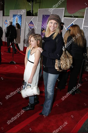 Stock Image of HOLLYWOOD, CALIFORNIA - JANUARY 17: Ava Elizabeth Sambora and Heather Locklear at the World Premiere of Walt Disney Pictures' 'Hannah Montana & Miley Cyrus: Best of Both World Concert' on January 17, 2008 at the El Capitan Theatre in Hollywood, CA.