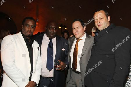 HOLLYWOOD, CA - APRIL 30: Sean 'P. Diddy' Combs, Faizon Love, Director/Exec. Producer Jon Favreau and Vince Vaughn and Robert Downey Jr. at the Paramount and Marvel Los Angeles Premiere of 'Iron Man' after party on April 30, 2008 at the Roosevelt Hotel in Hollywood, CA.
