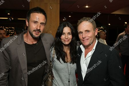 Stock Image of BEVERLY HILLS, CA - SEPTEMBER 17: David Arquette, Courteney Cox-Arquette and Producer/Co-Writer Robert Knott at New Line Cinema Special Los Angeles Screening of 'Appaloosa' on September 17, 2008 at the Academy Threatre in Beverly Hills, CA.