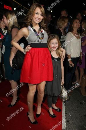 HOLLYWOOD, CA - NOVEMBER 17: Miley Cyrus and Sister Noah Lindsey Cyrus at Walt Disney Pictures 'Bolt' World Premiere on November 17, 2008 at the El Capitan Theatre in Hollywood, CA.