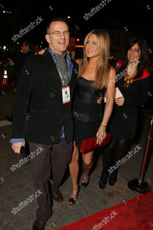 WESTWOOD, CA - DECEMBER 11: Stephen Huvane and Jennifer Aniston at 20th Century Fox Premiere of 'Marley & Me' on December 11, 2008 at Mann's Village Theatre in Westwood, California.