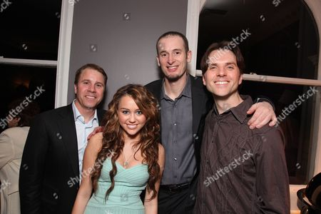 BEVERLY HILLS, CA - JANUARY 10: **EXCLUSIVE** Bolt Producer Clark Spencer, Miley Cyrus, Bolt Director Chris Williams and Bolt Director Byron Howard at Walt Disney Pictures/Miramax Pre Golden Globe Party on January 10, 2009 at the Beverly Wishire Hotel in Beverly Hills, California.