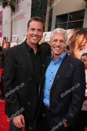 Stock Image of HOLLYWOOD, CA - APRIL 02: Screenwriter Dan Berendsen and ABC's Kevin Brockman at the World Premiere of Walt Disney Pictures 'Hannah Montana The Movie' on April 02, 2009 at the El Capitan Theatre in Hollywood, California.