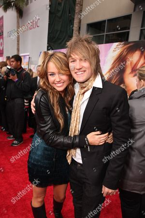 HOLLYWOOD, CA - APRIL 02: Miley Cyrus and Steve Rushton at the World Premiere of Walt Disney Pictures 'Hannah Montana The Movie' on April 02, 2009 at the El Capitan Theatre in Hollywood, California.