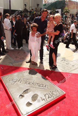 HOLLYWOOD, CA - APRIL 21: Oscar Maximillian Jackman, Hugh Jackman, wife Deborra-Lee Furness and Ava Eliot Jackman at Hugh Jackman's Hand and Footprint Ceremony on April 21, 2009 at Grauman's Chinese Theatre in Hollywood, California.