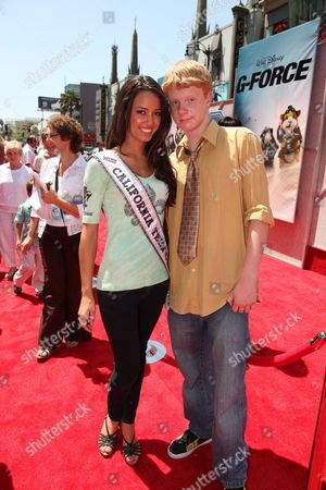 HOLLYWOOD, CA - JULY 19: Miss California Teen Chelsea Gilligan and Adam Hicks at The World Premiere of Walt Disney Pictures' 'G-Force' on July 19, 2009 at the El Capitan Theatre in Hollywood, California.