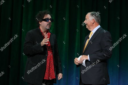 ANAHEIM, CA - SEPTEMBER 11: **EXCLUSIVE** Director Tim Burton and Disney's Dick Cook at Walt Disney Pictures Presentation at Disney's D23 Expo on September 11, 2009 at the Anaheim Convention Center in Anaheim, California.