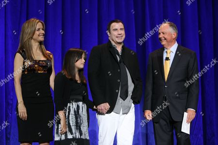 ANAHEIM, CA - SEPTEMBER 11: **EXCLUSIVE** Kelly Preston, Ella Bleu Travolta, John Travolta and Disney's Dick Cook at Walt Disney Pictures Presentation at Disney's D23 Expo on September 11, 2009 at the Anaheim Convention Center in Anaheim, California.