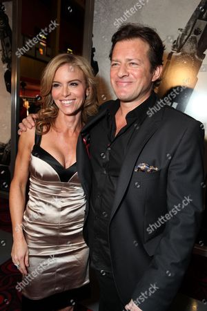 HOLLYWOOD, CA - OCTOBER 22: Betsy Russell and Costas Mandylor at Lionsgate's screening of 'Saw VI' on October 22, 2009 at The Mann's Chinese Six Theater in Hollywood, California.