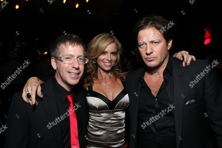 HOLLYWOOD, CA - OCTOBER 22: Director Kevin Greutert, Betsy Russell and Costas Mandylor at Lionsgate's screening of 'Saw VI' on October 22, 2009 at The Mann's Chinese Six Theater in Hollywood, California.