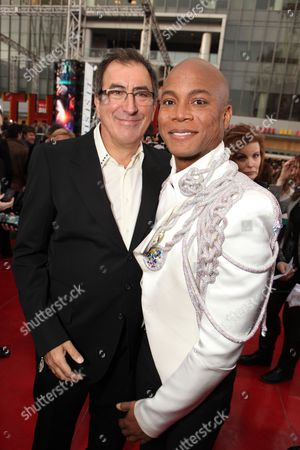 LOS ANGELES, CA - OCTOBER 27: Director/Producer Kenny Ortega and Asociate Producer/Choreographer Travis Payne at Columbia Pictures' Premiere of Michael Jackson's 'This Is It' on October 27, 2009 at the Nokia Theatre L.A. Live in Los Angeles, California.