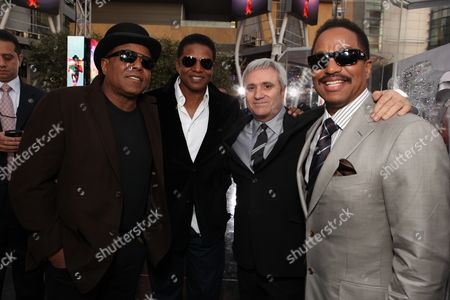 LOS ANGELES, CA - OCTOBER 27: Tito Jackson, Jackie Jackson, AEG's Randy Phillips and Marlon Jackson at Columbia Pictures' Premiere of Michael Jackson's 'This Is It' on October 27, 2009 at the Nokia Theatre L.A. Live in Los Angeles, California.