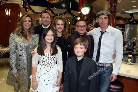 Stock Picture of HOLLYWOOD, CA - NOVEMBER 09: **EXCLUSIVE** Rita Wilson, John Travolta, Ella Bleu Travolta, Kelly Preston, Robin Williams, Conner Rayburn and Dax Shepard at the World Premiere of Walt Disney Pictures 'Old Dogs' on November 09, 2009 at the El Capitan Theatre in Hollywood, California.