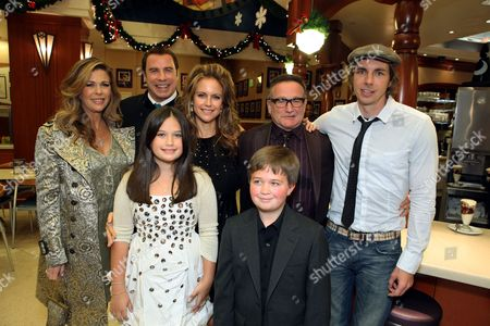 Stock Photo of HOLLYWOOD, CA - NOVEMBER 09: **EXCLUSIVE** Rita Wilson, John Travolta, Ella Bleu Travolta, Kelly Preston, Robin Williams, Conner Rayburn and Dax Shepard at the World Premiere of Walt Disney Pictures 'Old Dogs' on November 09, 2009 at the El Capitan Theatre in Hollywood, California.