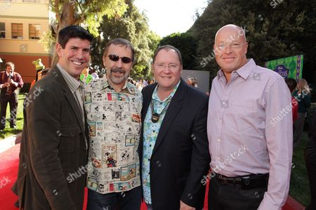 BURBANK, CA - NOVEMBER 15: Disney's Rich Ross, Disney/Pixar's Ed Catmull, Disney/Pixar's John Lasseter and Disney's Bob Chapek at the World Premiere of Disney's 'The Princess and The Frog' hosted by Walt Disney Studios on November 15, 2009 at Walt Disney Studios in Burbank, California.