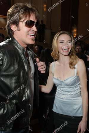 LOS ANGELES, CA - JANUARY 09: Billy Ray Cyrus and Katherine Boecher at the World Premiere of Lionsgate 'The Spy Next Door' on January 09, 2010 at The Gorve in Los Angeles, California.