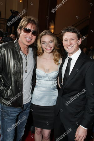 Stock Image of LOS ANGELES, CA - JANUARY 09: Billy Ray Cyrus, Katherine Boecher and Lukas Behnken at the World Premiere of Lionsgate 'The Spy Next Door' on January 09, 2010 at The Gorve in Los Angeles, California.