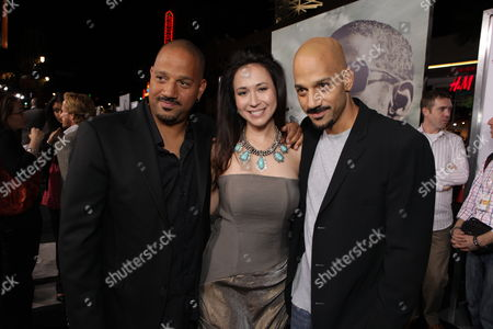 Stock Image of HOLLYWOOD, CA - JANUARY 11: Director Allen Hughes, Lora Cunningham and Director Albert Hughes at Warner Bros. Pictures Premiere of Alcon Entertainment's 'The Book of Eli' at Grauman's Chinese Theatre on January 11, 2010 in Hollywood, California.