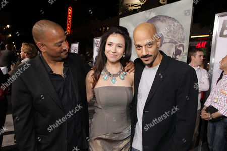HOLLYWOOD, CA - JANUARY 11: Director Allen Hughes, Lora Cunningham and Director Albert Hughes at Warner Bros. Pictures Premiere of Alcon Entertainment's 'The Book of Eli' at Grauman's Chinese Theatre on January 11, 2010 in Hollywood, California.