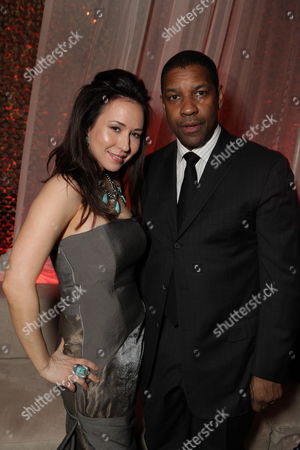 HOLLYWOOD, CA - JANUARY 11: **EXCLUSIVE** Lora Cunningham and Denzel Washington at Warner Bros. Pictures Premiere of Alcon Entertainment's 'The Book of Eli' at Grauman's Chinese Theatre on January 11, 2010 in Hollywood, California.
