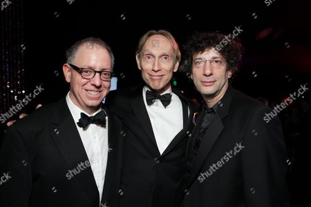 BEVERLY HILLS, CA - JANUARY 17: Focus' James Schamus, Director Henry Selick and Author Neil Gaiman at NBC/Universal/Focus Features Golden Globes party at the Beverly Hilton Hotel on January 17, 2010 in Beverly Hills, California.