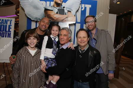 LOS ANGELES, CA - JANUARY 16: **EXCLUSIVE** Chase Ellison, Dwayne Johnson, Destiny Grace Whitlock, Director Michael Lembeck, Billy Crystal and Stephen Merchant as Tooth Fairy's Dwayne Johnson becomes an honorary L.A. Kings at the Los Angeles Kings Vs. Bonston Bruins Hockey Game at Staples Center on January 16, 2010 in Los Angeles, California.