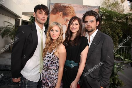 Stock Picture of HOLLYWOOD, CA - MARCH 25: Josh Nuncio, Cherilyn Wilson, Alli Kinsel and Adam Chambers at the World Premiere of Touchstone Pictures 'The Last Song' on March 25, 2010 at ArcLight Hollywood Cinema in Hollywood, CA.