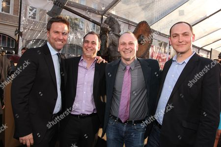 HOLLYWOOD, CA - MARCH 31: Producer Basil Iwanyk, Writer Matt Manfredi, Writer Phil Hay and Director Louis Leterrier at Warner Bros. Los Angeles Premiere of 'Clash of the Titans' on March 31, 2010 at the Grauman's Chinese Theatre in Hollywppd, CA.