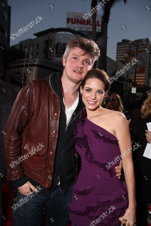 Stock Image of HOLLYWOOD, CA - APRIL 13: Producer Tarquin Pack and Lyndsy Fonseca at Lionsgate's Los Angeles Premiere of 'Kick Ass' on April 13, 2010 at Arclight Cinerama Dome in Hollywood, California.