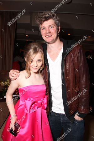 Stock Image of HOLLYWOOD, CA - APRIL 13: **EXCLUSIVE** Chloe Moretz and Producer Tarquin Pack at Lionsgate's Los Angeles Premiere of 'Kick Ass' on April 13, 2010 at Arclight Cinerama Dome in Hollywood, California.