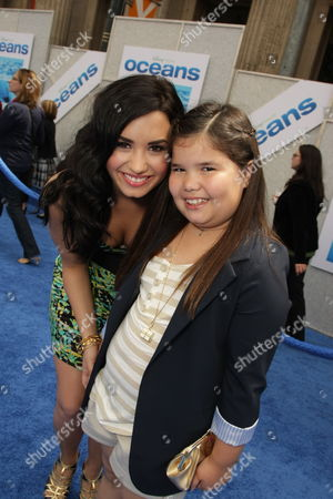 HOLLYWOOD, CA - APRIL 17: Demi Lovato and sister Madison De La Garza at Disneynature's premiere of 'Oceans' on April 17, 2010 at the El Capitan Theatre in Hollywood, California.