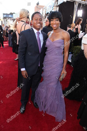 SUNDAY, JANUARY 29, 2012: Ian Alexander Jr. and Regina King at the 18th Annual Screen Actors Guild Awards held at the Shrine Auditiorium on January 29, 2012 in Los Angeles, California.
