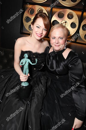 SUNDAY, JANUARY 29, 2012: Emma Stone and Krista Stone at the 18th Annual Screen Actors Guild Awards held at the Shrine Auditiorium on January 29, 2012 in Los Angeles, California.