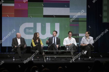 Pictured (L-R )Executive Producer Marc Guggenheim, Katie Cassidy, Stephen Amell, Executive Producer Greg Berlanti, and Executive Producer Andrew Kreisberg during ARROW's panel at THE CW TCA Summer Press Tour 2012, held at The Beverly Hilton in Los Angeles, CA on Monday, July 30, 2012 in Los Angeles, CA.