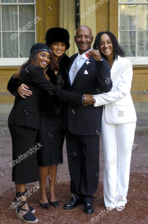 ERROL BROWN WITH HIS WIFE GINETTE AND DAUGHTERS LEONE(LEFT) AND COLETTE