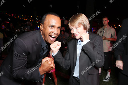 Sugar Ray Leonard and Dakota Goyo are seen at The U.S. Premiere of DreamWorks Pictures' Action Drama 'Real Steel' at the Gibson Amphitheatre at Universal CityWalk, on Sunday, October 2, 2011 in Universal City, California.