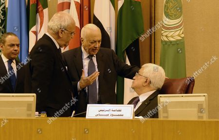 Palestinian President Mahmoud Abbas speaking with Arab League Secretary-General Nabil al-Araby during an Arab foreign ministers urgent meeting at the Arab League headquarters