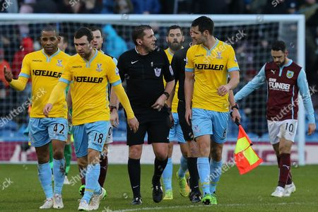 Scott Dann of Crystal Palace has a word with referee Mr. Phil Dowd as they leave the pitch at half time