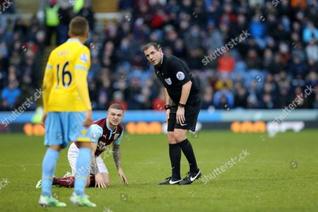 Kieran Trippier of Burnley looks towards Dwight Gayle of Crystal Palace as he complains about a foul to Referee Mr. Phil Dowd