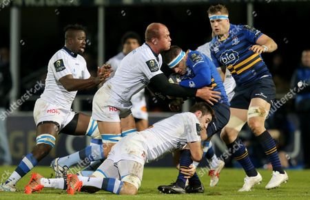 Leinster's Fergus McFadden with Paea Faanunu and Johnnie Beattie of Castres Olympique