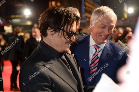 Johnny Depp signing a fan's face with bodyguard Jerry Judge