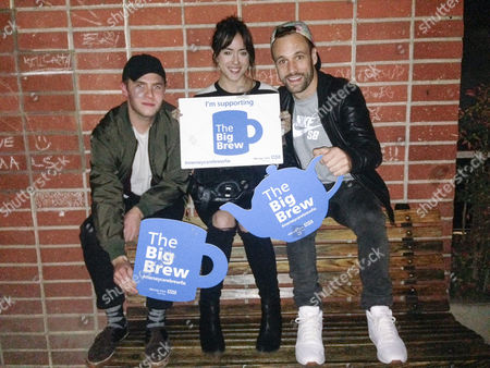 """Iain De Caestecker, Chloe Bennet and Nick Blood from Agents of Shield. Celebrities pose with """"Big Brew"""" placards in support of mental health awareness as today marks """"Blue Monday"""", the day regarded by many as the most depressing in the year"""