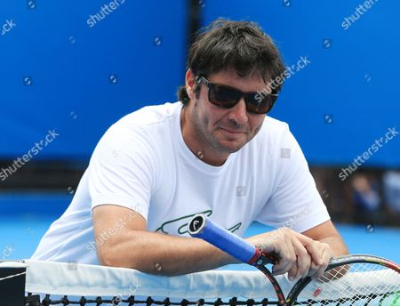 France's Sebastien Grosjean Coach to Richard Gasquet has a rest at the net during Andy Murray Practice Session