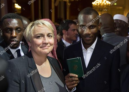 Pascale Boistard and Lassana Bathily and his french passport