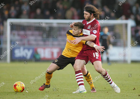 Stock Photo of Mark Byrne of Newport and John Joe O'Toole of Northampton compete for the ball