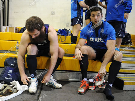 Johnnie Beattie - Scotland number 8 (R) laces up his boots alongside Geoff Cross.