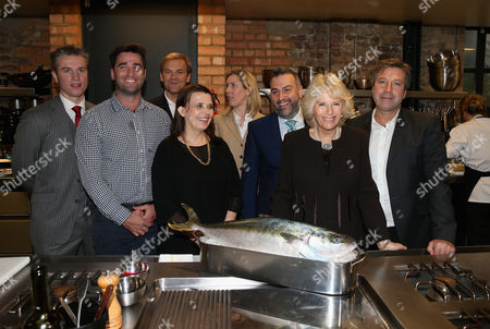 Camilla Duchess of Cornwall poses for a photograph with Australian chef Lynton Tapp (second left) and Rachel O'Sullivan, John Torode, Bill Granger, Luke Rayment, Christian Honor and Clare Smyth during a cooking demonstration
