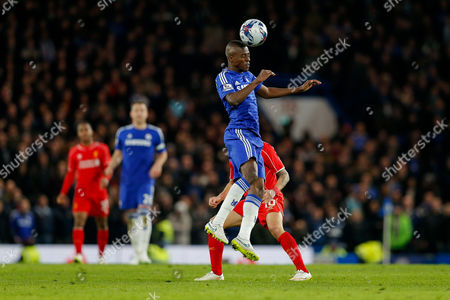 Ramires of Chelsea heads the ball as Philippe Coutinho of Liverpool challenges during extra time